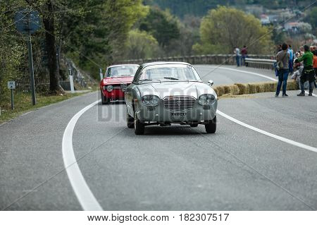 Trieste Italy - April 2 2017: Photo of a Lancia Flavia Zagato on the Trieste Opicina Historic. Trieste Opicina Historic is regularity run for vintage and classic Cars.