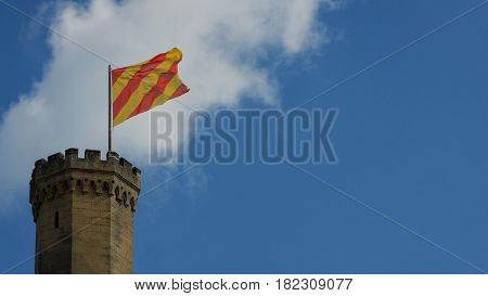 Castle tower with flag. Southern France, Europe