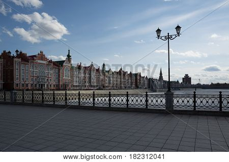 Yoshkar-Ola, Russia - April 13, 2017 Photo of beautiful houses in Belgian style on the Brugge embankment in the central part of the city of Yoshkar-Ola, Russia