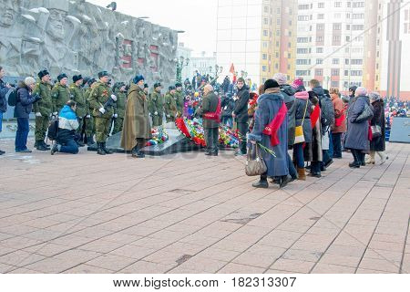 NORILSK, RUSSIA - MAY 9, 2016 Veterans approach the eternal flame