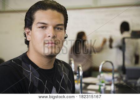 Hispanic teenage boy in chemistry lab