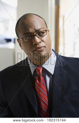 African businessman in eyeglasses thinking