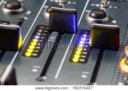 Close up shot of a DJ mixer volume faders
