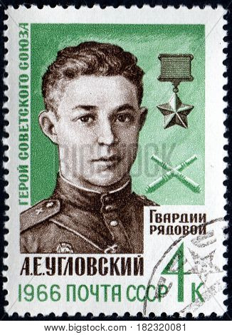 UKRAINE - CIRCA 2017: A postage stamp printed in USSR shows Portrait of Hero of USSR A. E. Uglovskij 1923-1943 from the series Heroes of Second World War circa 1966