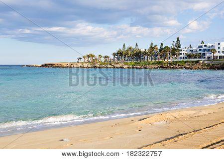 Travel, vacation, summer concept - Beautiful landscape beach, Cyprus island, Mediterranean Sea. Amazing blue sea and sunny day