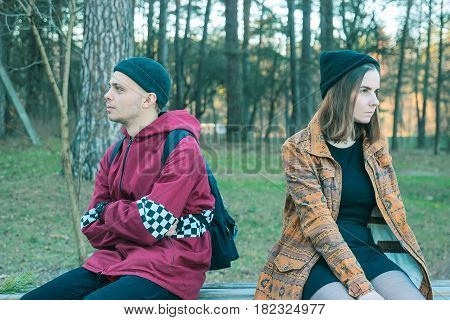two happy homeless man and woman take offense at one another