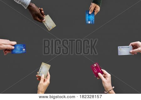 Group of hands holding credit card convenience life with copy space in aerial view