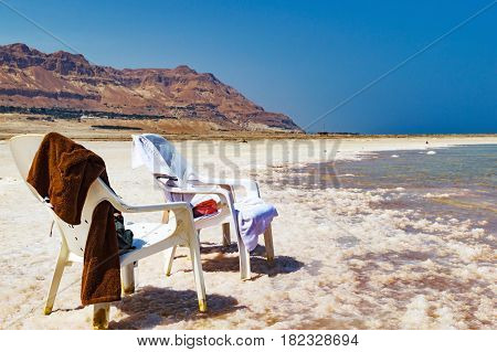 White Chairs On The Shore Of The Dead Sea