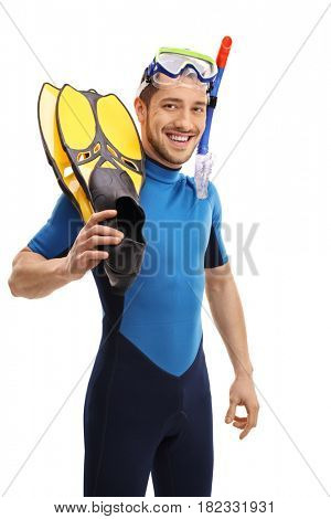 Guy in a wetsuit with snorkeling equipment looking at the camera and smiling isolated on white background