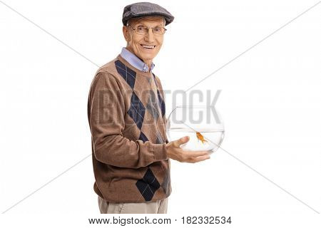 Elderly man holding a bowl with a goldfish and looking at the camera isolated on white background