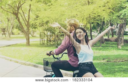 Lover with happy time on their bike