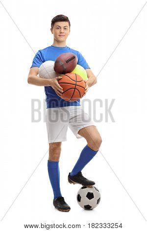Full length portrait of a teenage athlete with different kinds of sports balls isolated on white background