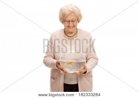 Mature woman holding a bowl with a goldfish isolated on white background