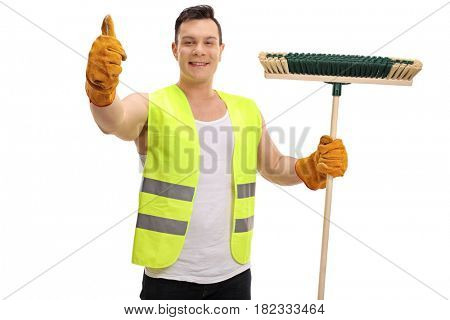 Happy waste collector holding a broom and making a thumb up sign isolated on white background