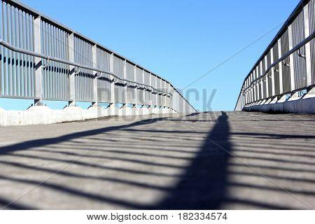 Bridge to no-where with blue sky background