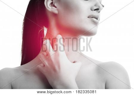 Young woman suffering from sore throat isolated over white