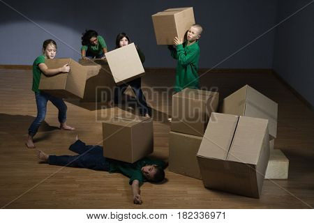 Children moving cardboard boxes