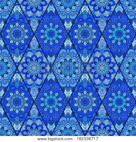 Blue tile seamless pattern. Luxury floral patchwork background. Mandala boho decoration. Intricate flower ornament. Rhombus design elements. Portuguese moroccan motif. Unusual oriental flourish print.