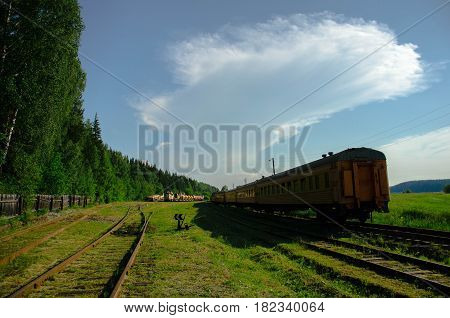 Old railway carriage on the abandoned railroad