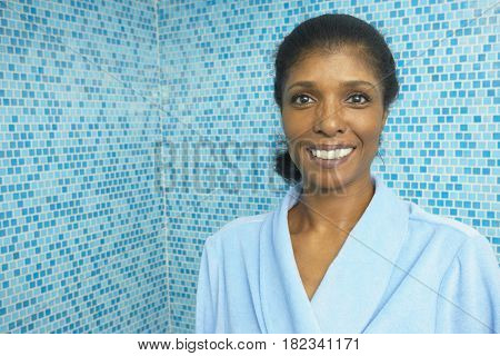 Smiling mixed race woman in bathroom