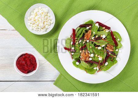 Caramelized Walnuts Salad On White Plate