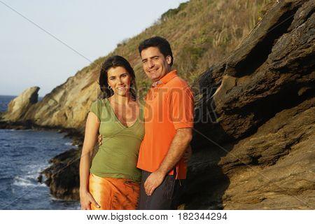 Couple hugging near ocean