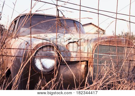 Dilapidated car rusty abandoned (Vintage effect style pictures)