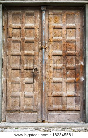brown grunge rusty metal door of church