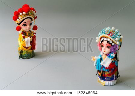 Traditional married Chinese dolls isolate on gray background - Focus on groom