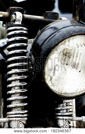 Color shot of a vintage motorcycle front shock absorber and front lights