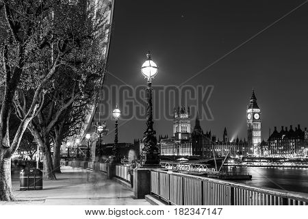 London, UK - April 7, 2017: Black and white artistic night photo of London Eye, Big Ben and Palace of Westminster aka Houses of parliament on 7th of April, 2017 in London, UK.