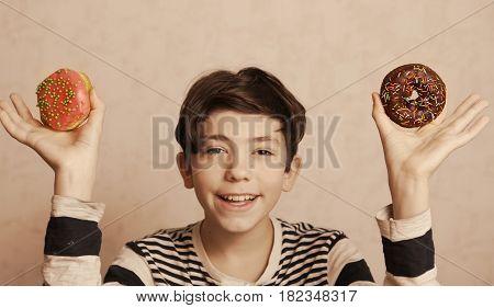 Teenager Boy Hold Doughnuts