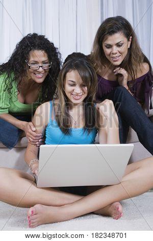 Multi-generational women looking at laptop