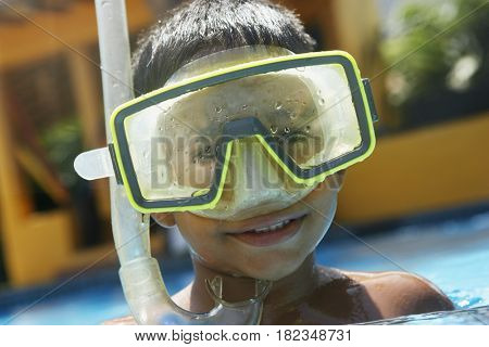 Hispanic boy in goggles and snorkel