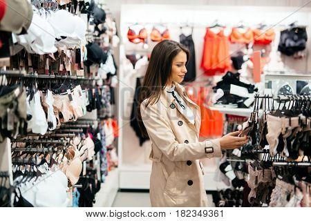Beautiful young pretty woman shopping sexy lingerie