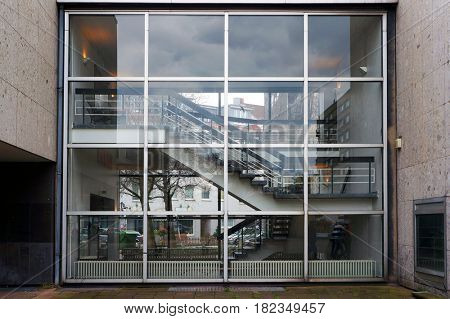 Glassed-in staircase of modern building.