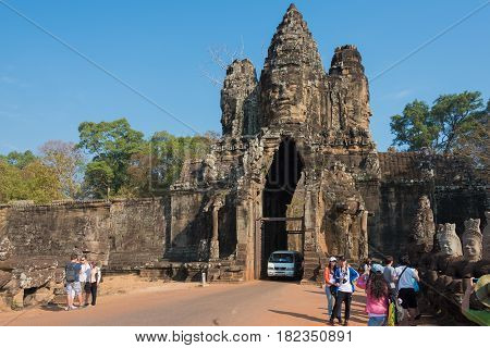 Siem Reap, Cambodia - Feb 3 2015: Visitors At Angkor Thom. A Famous Historical Site(unesco World Her