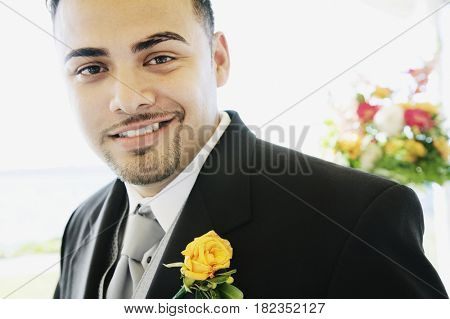 Hispanic man wearing tuxedo