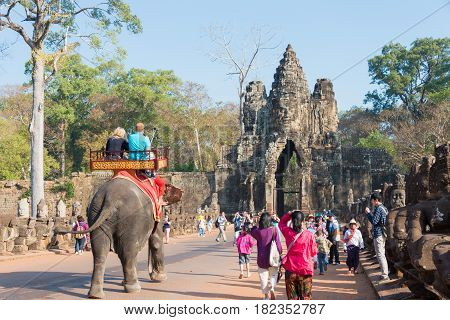 Siem Reap, Cambodia - Feb 4 2015: Visitors At Angkor Thom. A Famous Historical Site(unesco World Her