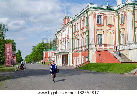TALLINN ESTONIA - MAY 15: People walk in the park Kadriorg on May 15 2016 in Tallinn Estonia.