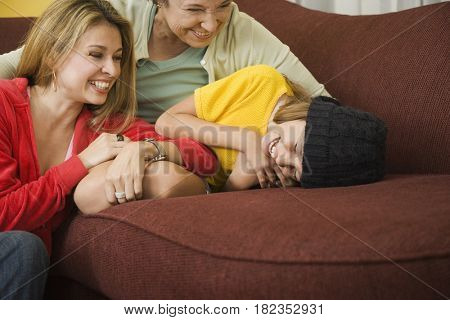 Hispanic grandmother, mother and daughter bonding