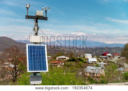 MOTSAMETA, GEORGIA - APRIL 01, 2017: Solar panel with mountains background and clear blue sky