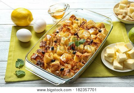 Glass dish with delicious bread pudding on napkin
