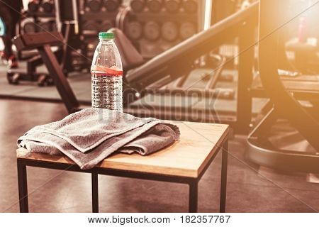 The abstract blur fitness gym background at sunny day with drink water