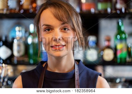 small business, service, alcohol and people concept - happy smiling barmaid or woman at restaurant or cocktail bar