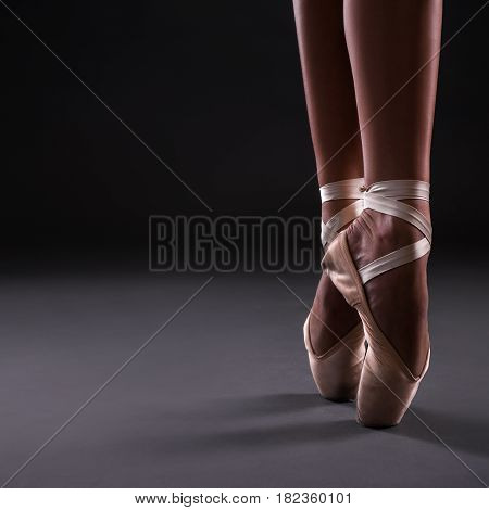 Close Up Of Ballerina Legs In Pointes Ober Gray