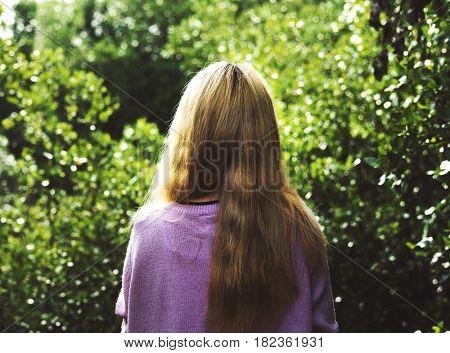 Woman back side portrait outdoors nature peaceful