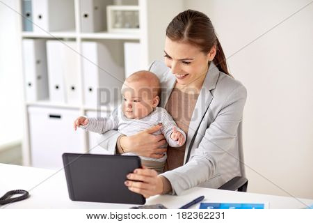 business, motherhood, multi-tasking, family and people concept - happy smiling businesswoman with baby and tablet pc computer working at office