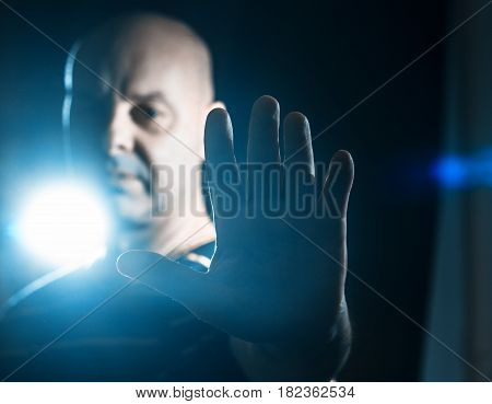 Man making stop sign rejective hand gesture on the black