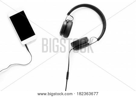 Headset And A Phone On White Background